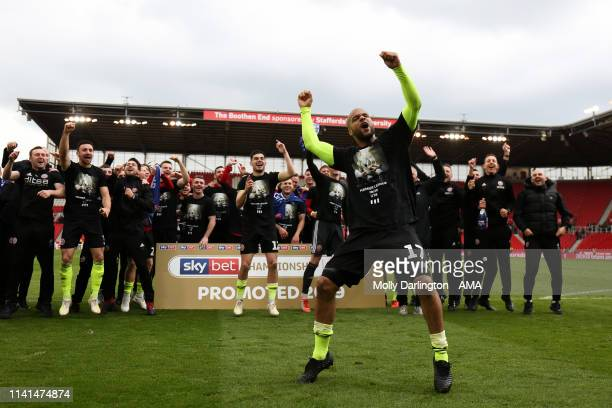 David McGoldrick of Sheffield United celebrates promotion to the Premier League during the Sky Bet Championship match between Stoke City and...