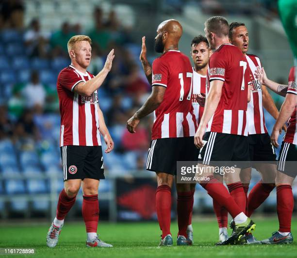 David McGoldrick of Sheffield United celebrates with his teammate Mark Duffy of Sheffield United after scoring the opening goal during a preseason...