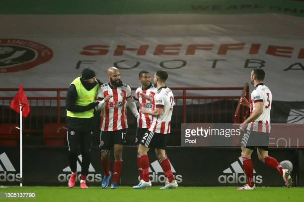 David McGoldrick of Sheffield United celebrates with Rhian Brewster, George Baldock and Enda Stevens after scoring their side's first goal during the...