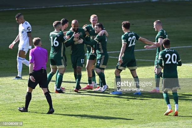 David McGoldrick of Sheffield United celebrates with teammates Oliver Norwood, Oliver McBurnie and John Fleck after their team's first goal scored by...