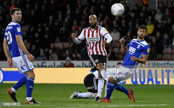 David McGoldrick of Sheffield United gets a shot on goal pass Maxime Colin of Birmingham City during the Sky Bet Championship match between Sheffield...