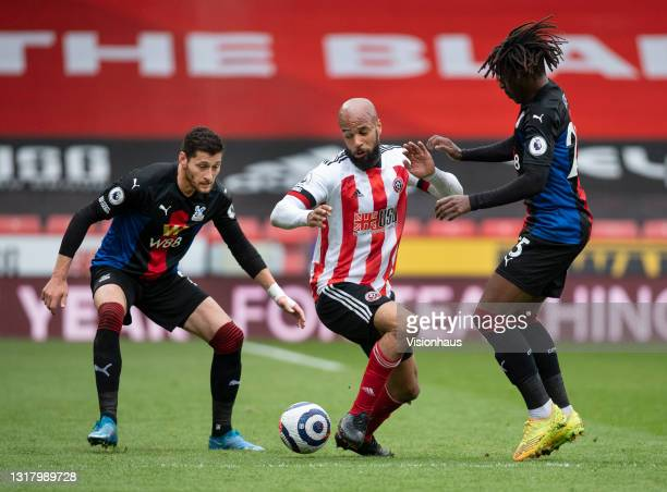 David McGoldrick of Sheffield United in action with Eberechi Eze and Joel Ward of Crystal Palace during the Premier League match between Sheffield...