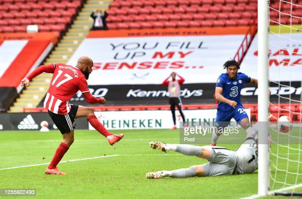 David McGoldrick of Sheffield United scores his team's first goal past Kepa Arrizabalaga of Chelsea during the Premier League match between Sheffield...