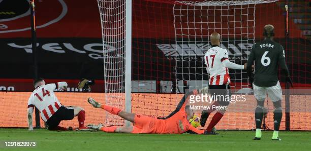 David McGoldrick of Sheffield United scores their first goal during the Premier League match between Sheffield United and Manchester United at...