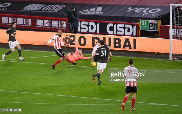 David McGoldrick of Sheffield United scores their sides first goal past Dean Henderson of Manchester United during the Premier League match between...