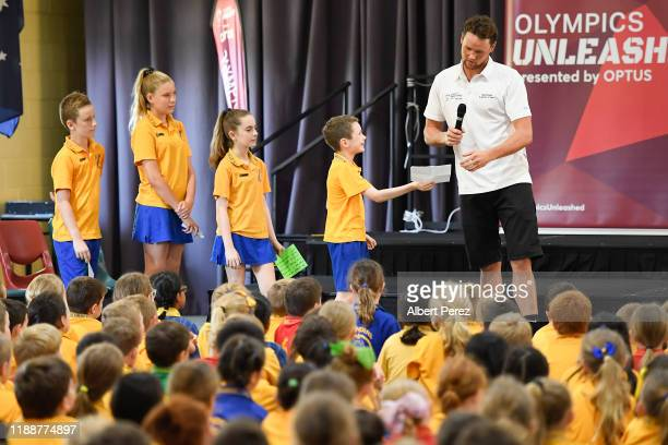David McKeon answers questions from students during the Australian Olympic Committee Unleashed visit to Graceville State School on November 20, 2019...