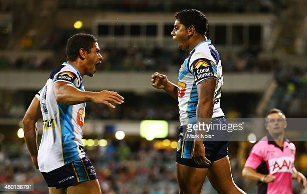 David Mead and Albert Kelly of the Titans celebrate a try by Kelly during the round three NRL match between the Canberra Raiders and the Gold Coast...
