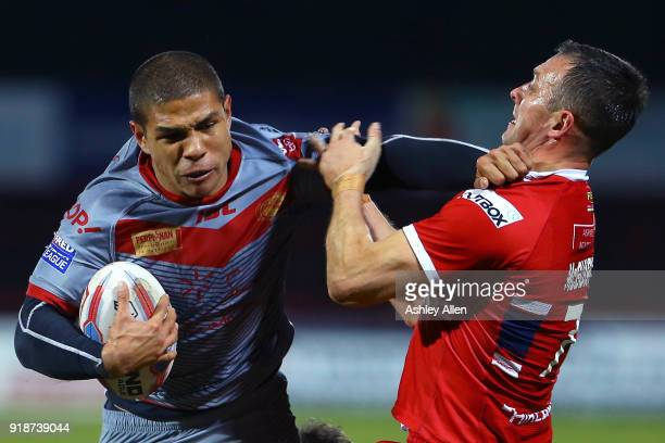 David Mead of the Catalans Dragons pushes aside Hull KR's Danny McGuire during the BetFred Super League match between Hull KR and Catalans Dragons at...
