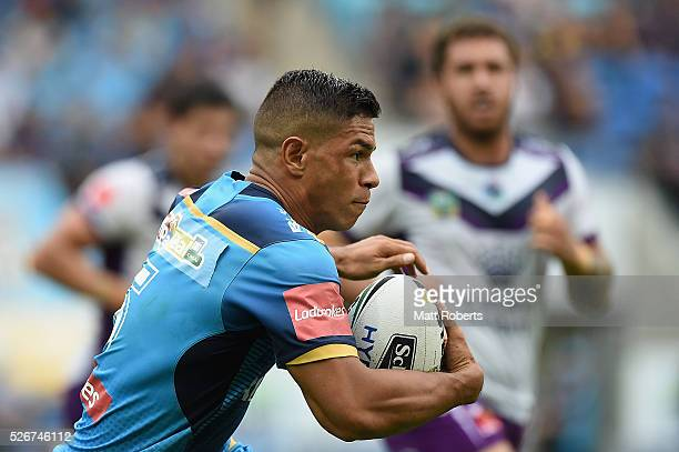 David Mead of the Titans runs with the ball during the round nine NRL match between the Gold Coast Titans and the Melbourne Storm on May 1 2016 in...
