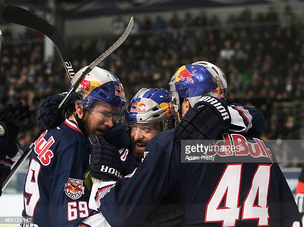 David Meckler of EHC Muenchen is congratualted by team mates after scoring a goal during the DEL Ice Hockey match between EHC Muenchen and Eisbaeren...