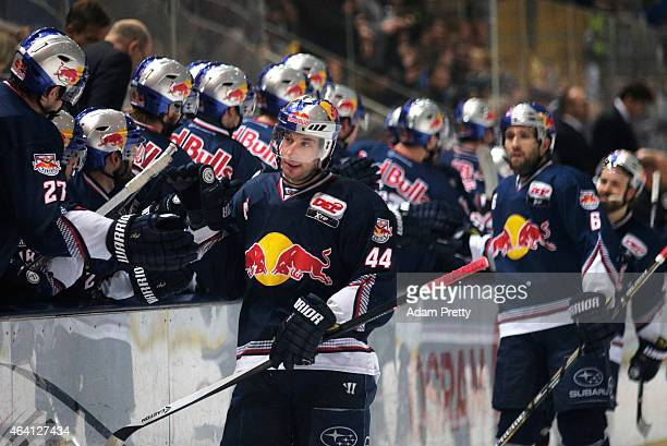 David Meckler of EHC Muenchen is congratulated after scoring a goal during the DEL Ice Hockey match between EHC Muenchen and Eisbaeren Berlin on...