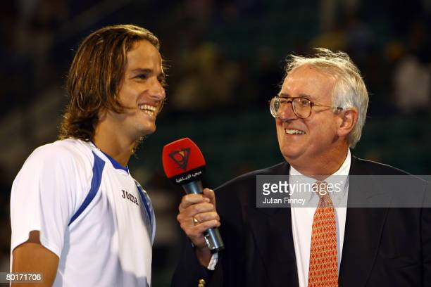 David Mercer interviews the runner up Feliciano Lopez of Spain after his match against Andy Roddick of United States in the final during the ATP...