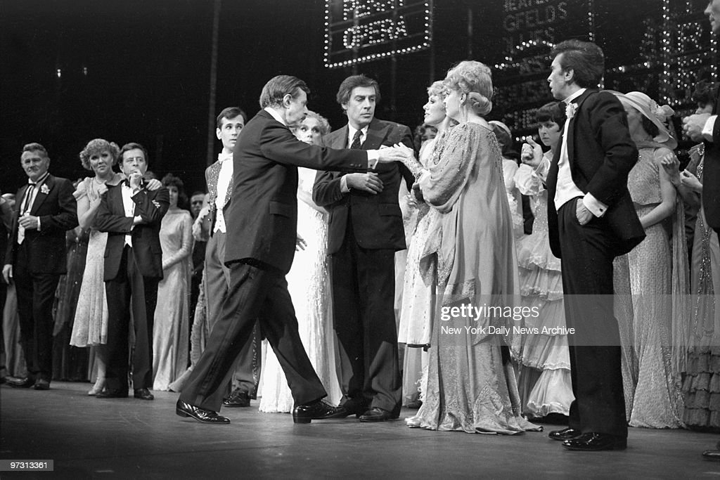 David Merrick reaches out to Wanda Richert, who co-stars in the show, after he announced the death of legendary choreographer and director Gower Champion at curtain call on opening night of Broadway show '42nd Street'. In center is Jerry Orbach.