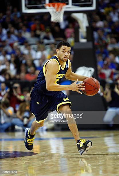David Merritt of the Michigan Wolverines dribbles the ball upcourt against the Oklahoma Sooners during the second round of the NCAA Division I Men's...