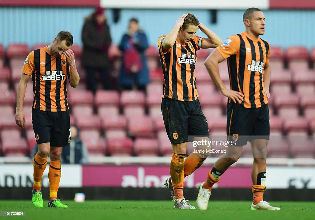 David Meyler, Michael Dawson and Jake Livermore of Hull City look despondent after defeat in the Barclays Premier League match between West Ham United and Hull City at Boleyn Ground on January 18, 2015 in London, England.