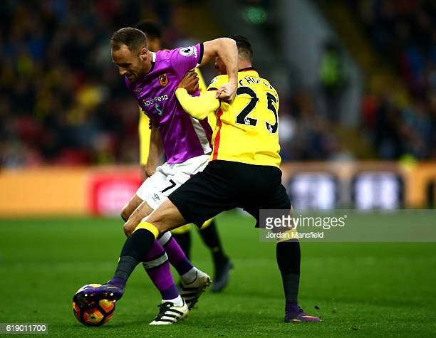 David Meyler of Hull City and Jose Holebas of Watford battle for possession during the Premier League match between Watford and Hull City at Vicarage...