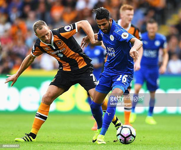 David Meyler of Hull City and Riyad Mahrez of Leicester City battle for possession during the Premier League match between Hull City and Leicester...