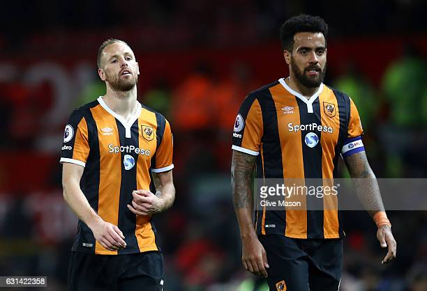 David Meyler of Hull City and Tom Huddlestone of Hull City look on during the EFL Cup SemiFinal First Leg match between Manchester United and Hull...