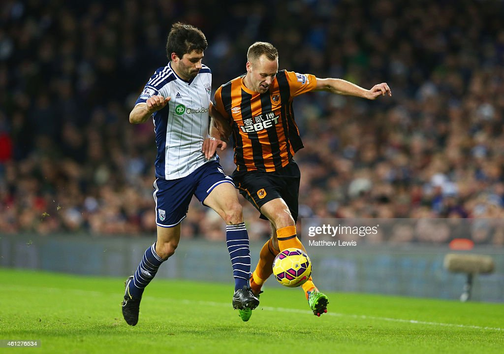 David Meyler of Hull City battles with Claudio Yacob of West Bromwich Albion during the Barclays Premier League match between West Bromwich Albion and Hull City at The Hawthorns on January 10, 2015 in West Bromwich, England.