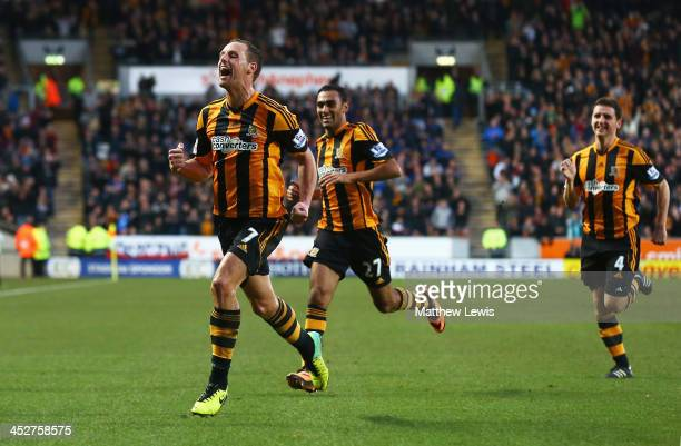 David Meyler of Hull City celebrates scoring his team's second goal with team mates during the Barclays Premier League match between Hull City and...