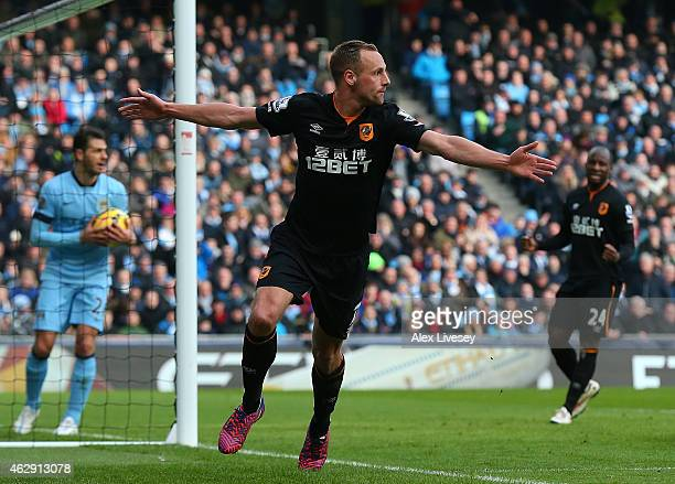 David Meyler of Hull City celebrates scoring the first goal during the Barclays Premier League match between Manchester City and Hull City at the...