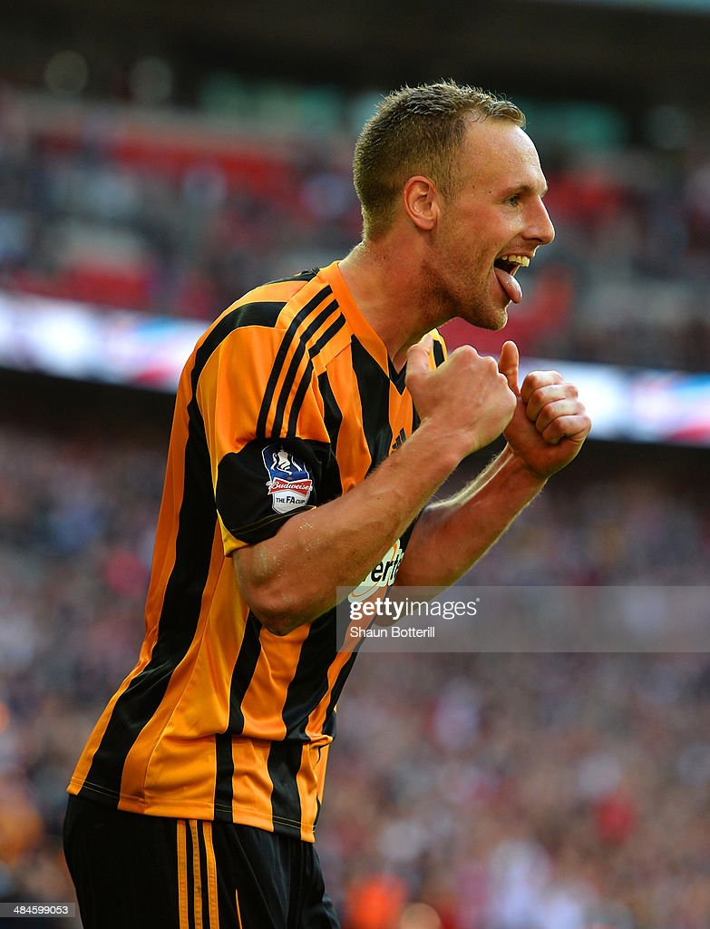 David Meyler of Hull City celebrates scoring their fifth goal during the FA Cup with Budweiser semi-final match between Hull City and Sheffield United at Wembley Stadium on April 13, 2014 in London, England.