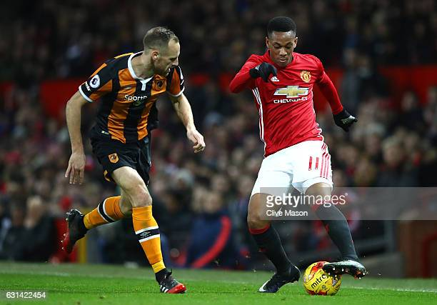 David Meyler of Hull City closes down Anthony Martial of Manchester United during the EFL Cup SemiFinal First Leg match between Manchester United and...