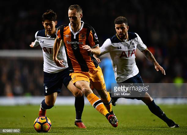David Meyler of Hull City controls the ball under pressure of HeungMin Son and Kyle Walker of Tottenham Hotspur during the Premier League match...