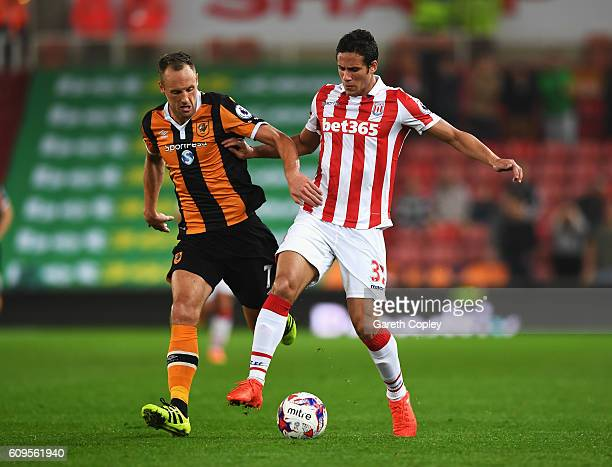 David Meyler of Hull City Daniel Bachmann of Stoke City during the EFL Cup Third Round match between Stoke City and Hull City at the Bet365 Stadium...
