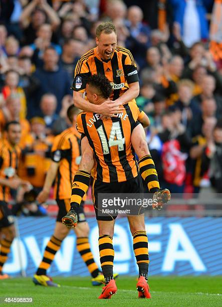 David Meyler of Hull City is congratulated on scoring their fifth goal by Jake Livermore of Hull City during the FA Cup with Budweiser semifinal...