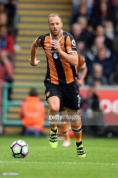 David Meyler of Hull City runs with the ball during the Premier League match between Swansea City and Hull City at Liberty Stadium on August 20 2016...