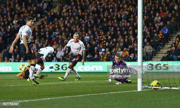 David Meyler of Hull City scores past goalkeeper Simon Mignolet of Liverpool during the Barclays Premier League match between Hull City and Liverpool...