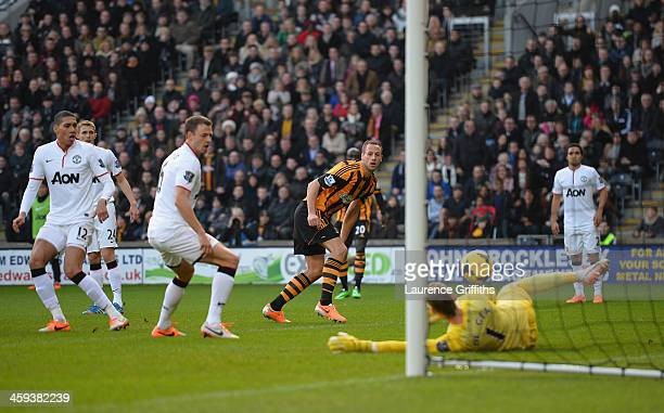 David Meyler of Hull City scores the second goal past David De Gea of Manchester United during the Barclays Premier League match between Hull City...
