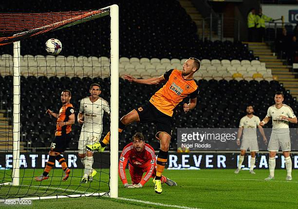 David Meyler of Hull City scores their opening goal during the Capital One Cup third round match between Hull City and Swansea City at KC Stadium on...