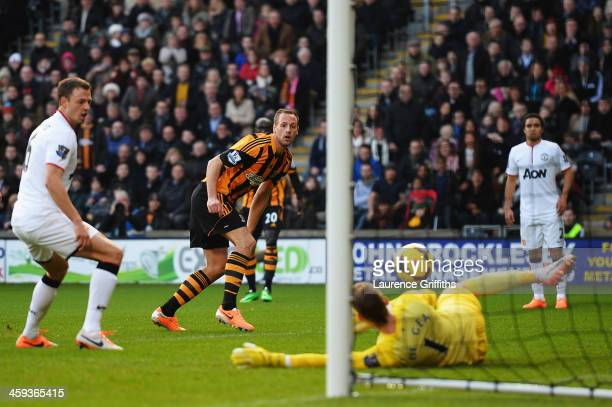 David Meyler of Hull City slots the ball past David De Gea the Manchester United goalkeeper to score his sides second goal during the Barclays...