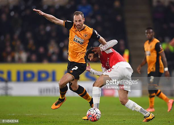 David Meyler of Hull City tangles with Mohamed Elneny of Arsenal during the Emirates FA Cup Fifth Round Replay match between Hull City and Arsenal at...