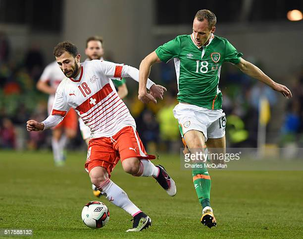 David Meyler of the Republic of Ireland and Admir Mehmedi of Switzerland during the international friendly match between the Republic of Ireland and...