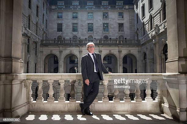 David Miles, monetary policy committee member at the Bank of England , poses for a photograph following an interview at the BOE in the City of...