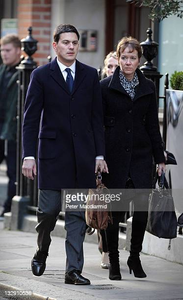 David Miliband and his wife Louise Shackelton arrive for the funeral of Philip Gould at All Saints church on November 15 2011 in London England Lord...