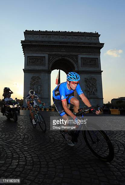 David Millar of Great Britain and GarminSharp attacks in a breakaway from thr Arc d'Triomphe during the twenty first and final stage of the 2013 Tour...