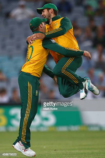 David Miller and Rilee Rossouw of South Africa celebrate after Miller took the catch to dismiss Shane Watson of Australia during game three of the...