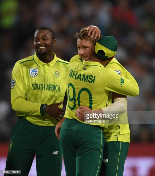 David Miller and team mates of South Africa celebrate the wicket of Mohammad Rizwan of Pakistan during the 1st KFC T20 International match between...