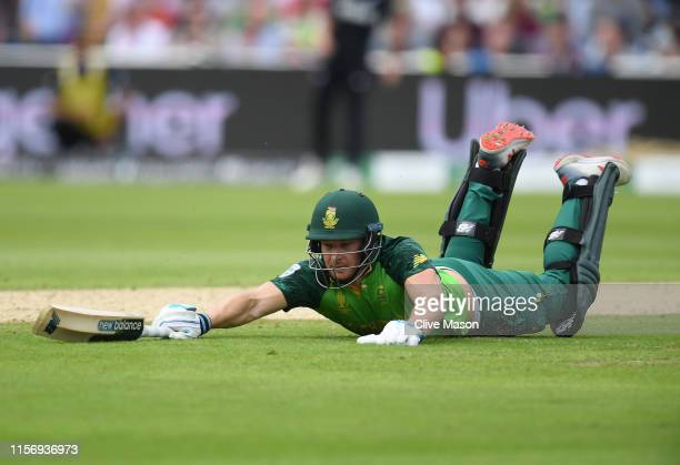 David Miller of South Africa dives to make his ground during the Group Stage match of the ICC Cricket World Cup 2019 between New Zealand and South...