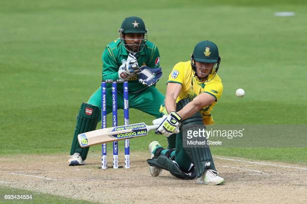 David Miller of South Africa sweeps as wicketkeeper Sarfraz Ahmed of Pakistan looks on during the ICC Champions Trophy match between Pakistan and...