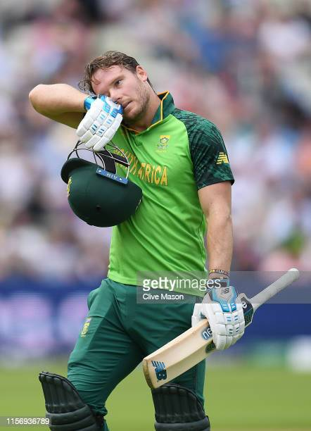 David Miller of South Africa walks off after being dismissed off the bowling of Lockie Ferguson of New Zealand looks on during the Group Stage match...