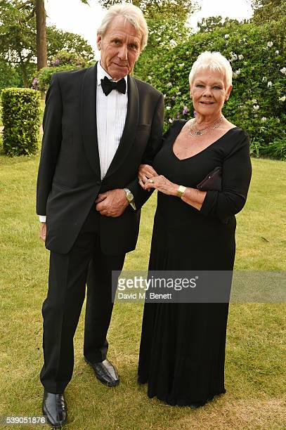 David Mills and Dame Judi Dench attend the Duke of Edinburgh Award 60th Anniversary Diamonds are Forever Gala at Stoke Park on June 9 2016 in...