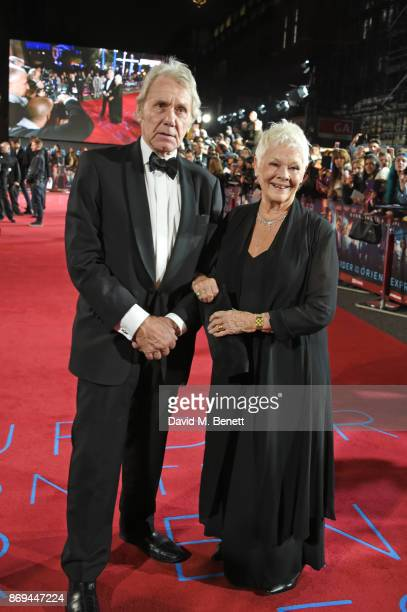 David Mills and Dame Judi Dench attend the World Premiere of 'Murder On The Orient Express' at The Royal Albert Hall on November 2 2017 in London...