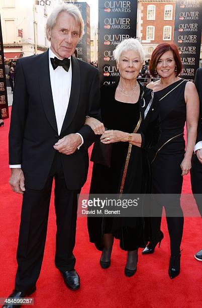 David Mills, Dame Judi Dench and Finty Williams attend the Laurence Olivier Awards at The Royal Opera House on April 13, 2014 in London, England.
