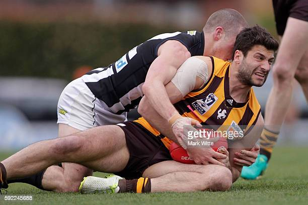 David Mirra of Box Hill Hawks gets tackled by Jack Frost of Collingwood Magpies during the round 20 VFL match between the Box Hill Hawks and the...