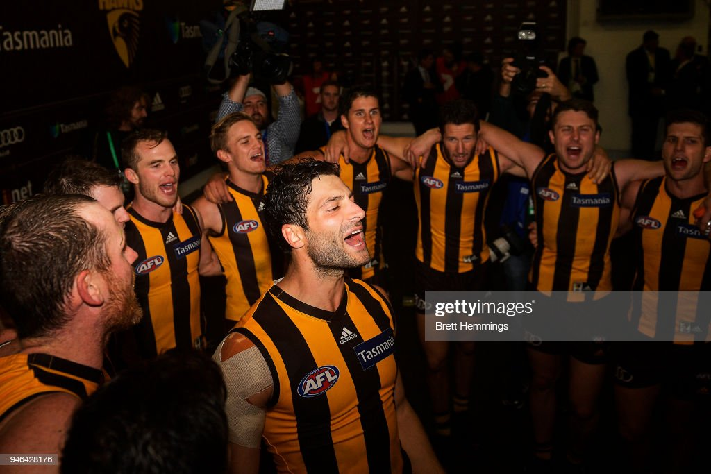 David Mirra of the Hawks celebrates victory with team mates during the round four AFL match between the Hawthorn Hawks and the Melbourne Demons at Melbourne Cricket Ground on April 15, 2018 in Melbourne, Australia.